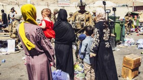 Marines process evacuees at Hamid Karzai International Airport, Kabul, Afghanistan, Aug. 28, 2021. U.S. service members are assisting the Department of State with a non-combatant evacuation operation in Afghanistan.
