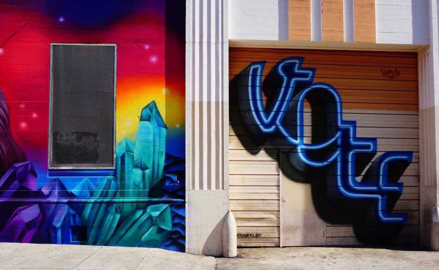 """Two colorful murals, one reading the word """"VOTE,"""" at Ninth Ave. and G Street in Downtown San Diego. Nov. 3, 2020."""