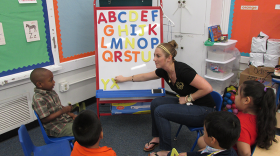 Teacher Jamie Stippel coaches her students on the last five letters of the alphabet.