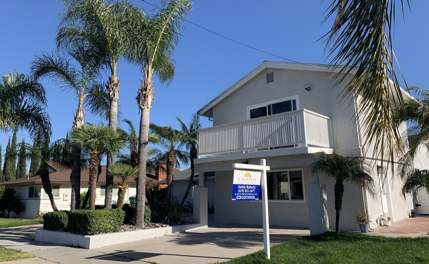 A home is listed for sale in the San Carlos neighborhood of San Diego, April 3, 2021.