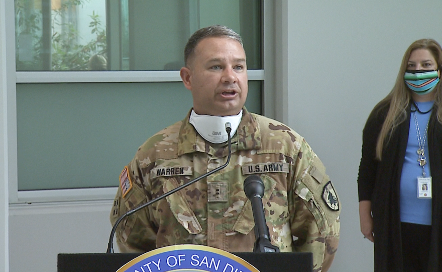 California National Guard Chief Warrant Officer Brandon Warren speaks during a news conference in Oceanside, March 15, 2021.