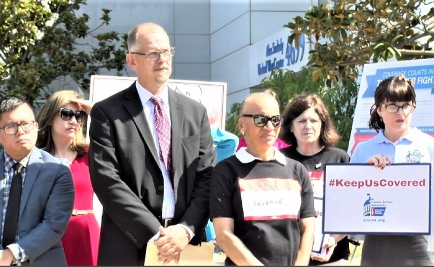Members of the coalition San Diegans for Healthcare Coverage listen to a speaker railing against Republican attempts to replace Obamacare, July 26, 2017.