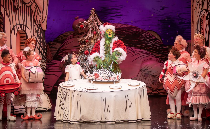 """Sophia Adajar as Cindy-Lou Who and Edward Watts as The Grinch with the cast of """"Dr. Seuss's How the Grinch Stole Christmas!"""" From 2019 stage production."""