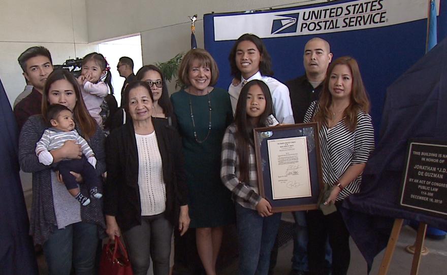 Congresswoman Susan Davis poses for a photo with De Guzman's family during Monday's dedication ceremony. March 6, 2017.