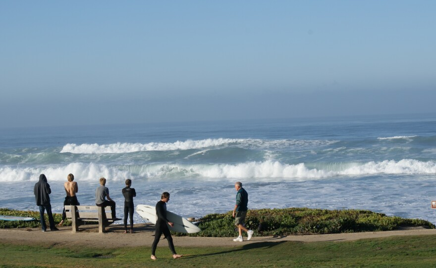 Bystanders gathered along the beach in Del Mar to watch the huge waves on January 14, 2010.