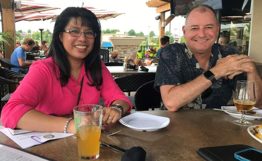 Army veterans Emma Toops and Scott Weaver meet for drinks at a rooftop bar in Overland Park, Kansas. They both served in Afghanistan, and they say the legacy of the decades-long war legacy defies easy explanations.