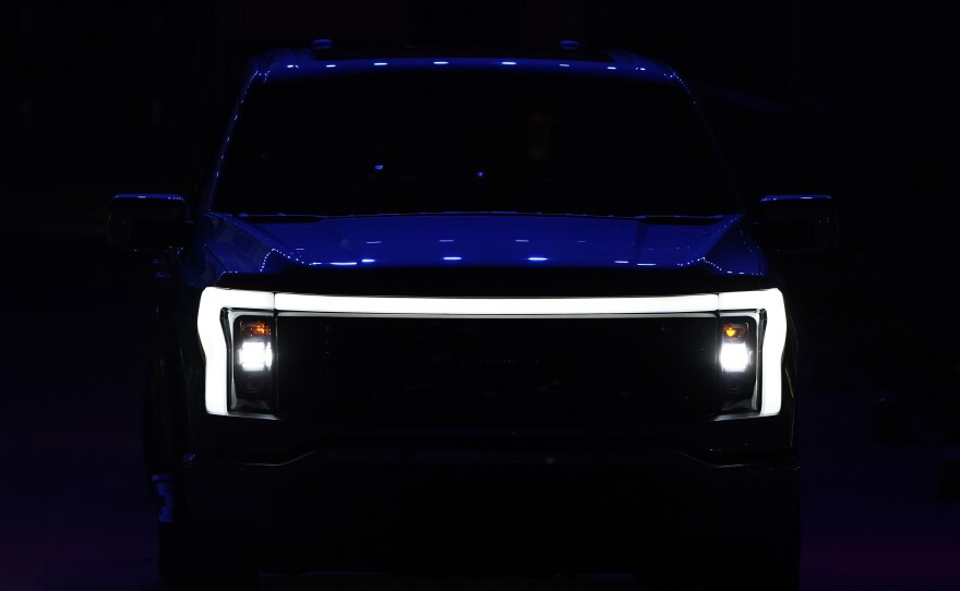 Pictured is the front grill of the new Ford F-150 Lightning unveiled on Wednesday in Dearborn, Mich. The electric version of Ford's bestselling pickup truck marks a major push to get buyers to switch to electric vehicles.