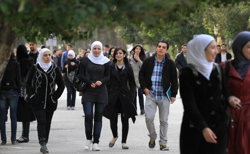 Syrian students on campus at a Damascus university in 2012, a year after the war started.