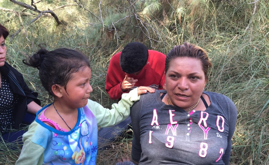 The Border Patrol apprehends a Salvadoran mother and her frightened daughter with a group of seven Central Americans down by the Rio Grande.
