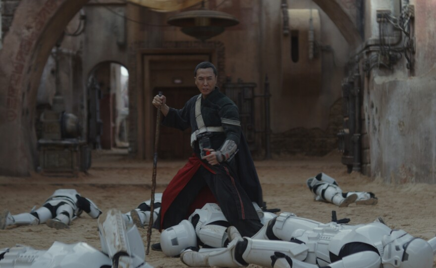 """Donnie Yen's Chirrut Îmwe takes out some stormtroopers in """"Rogue One: A Star Wars Story."""""""