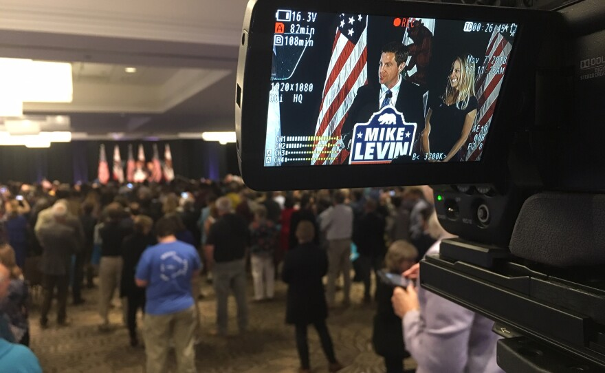 Mike Levin, Democratic candidate for the 49th Congressional District, is shown through a video camera on election night, Nov. 6, 2018.