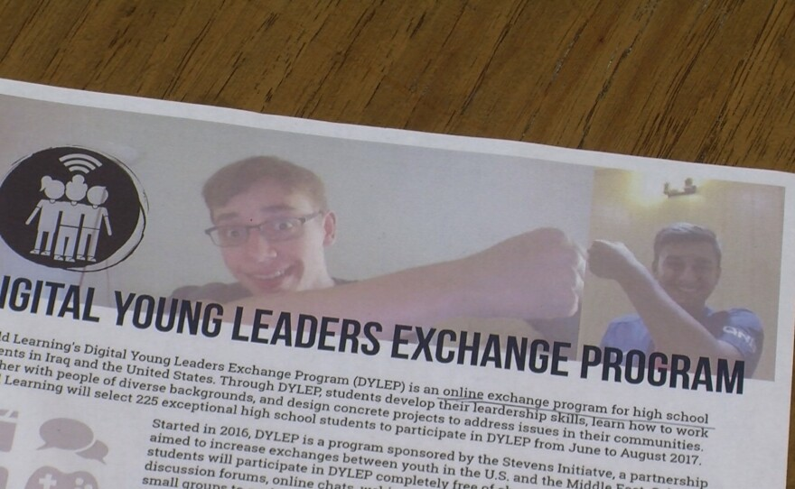 On a flyer for the Digital Young Leaders Exchange Program, two students engage in a virtual fist bump while communicating via an online video conferencing service.