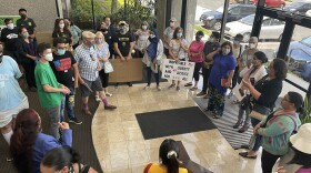 """Members of the organization """"Justice Overcoming Boundaries"""" and other community members rally outside of Darrell Issa's San Marcos district office. July 22, 2021."""