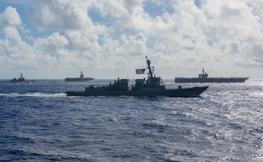 USS Bunker Hill, assigned to the Theodore Roosevelt Carrier Strike Group, and the Nimitz Carrier Strike Group participate in dual-carrier operations in the Philippine Sea on June 23, 2020.