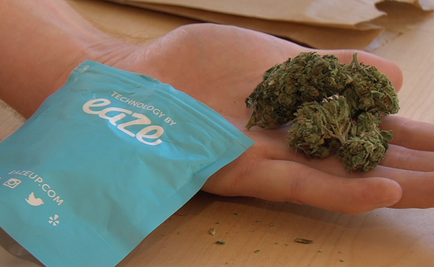 An eighth of an ounce of marijuana is seen next to the packaging of the pot delivery app Eaze, Nov. 6, 2015.