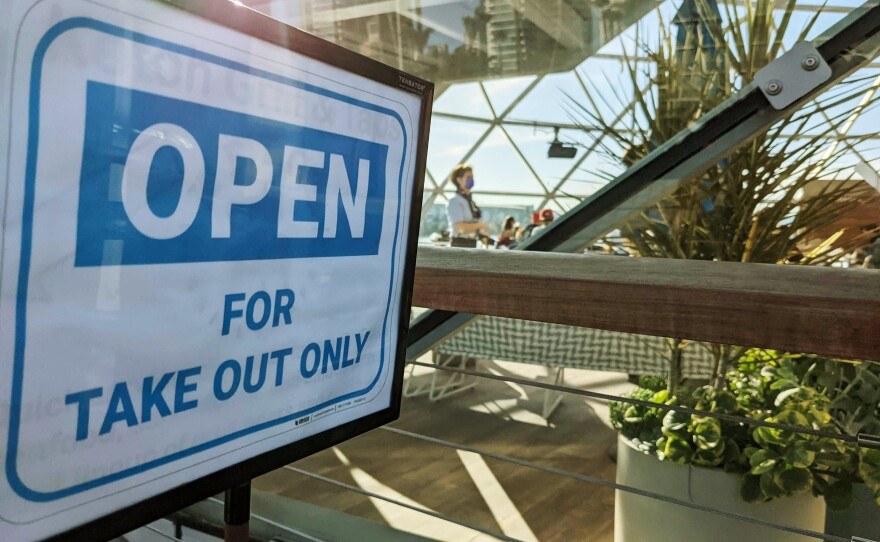 """A sign outside Ketch Brewing at the Embarcadero in downtown San Diego reads """"Open For Take Out Only,"""" Dec. 13, 2020."""