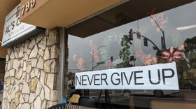 A sign is shown in a Carlsbad restaurant defying orders to close down in-person dining on January 5, 2021.