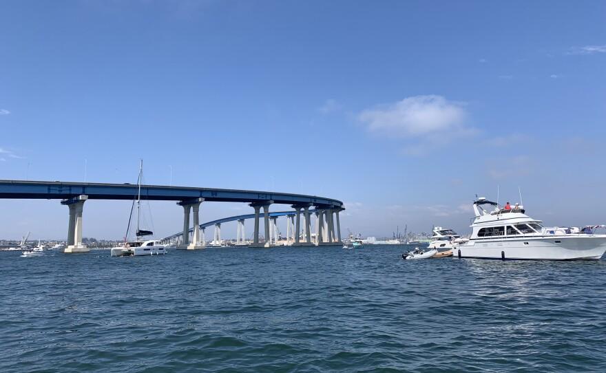 A boat drives away from the Coronado Bridge, July 3, 2021.