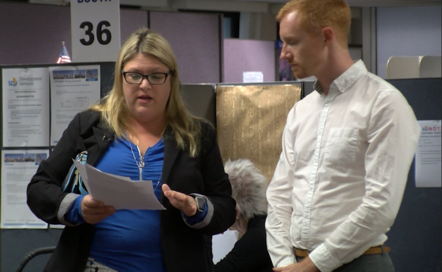 Elyse Lowe, deputy director of San Diego's Development Services Department, shows KPBS reporter Andrew Bowen an application for a marijuana production facility, Nov. 6, 2017.