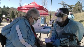 80-year-old Tera Parker gets a COVID-19 vaccine outside the Julian Library, Feb. 3rd, 2021.