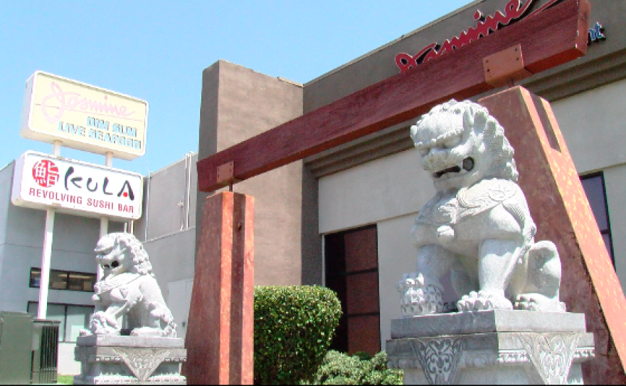 Sculptured lions guard the front of Jasmine Seafood Restaurant on Convoy Street. Aug. 25, 2016.