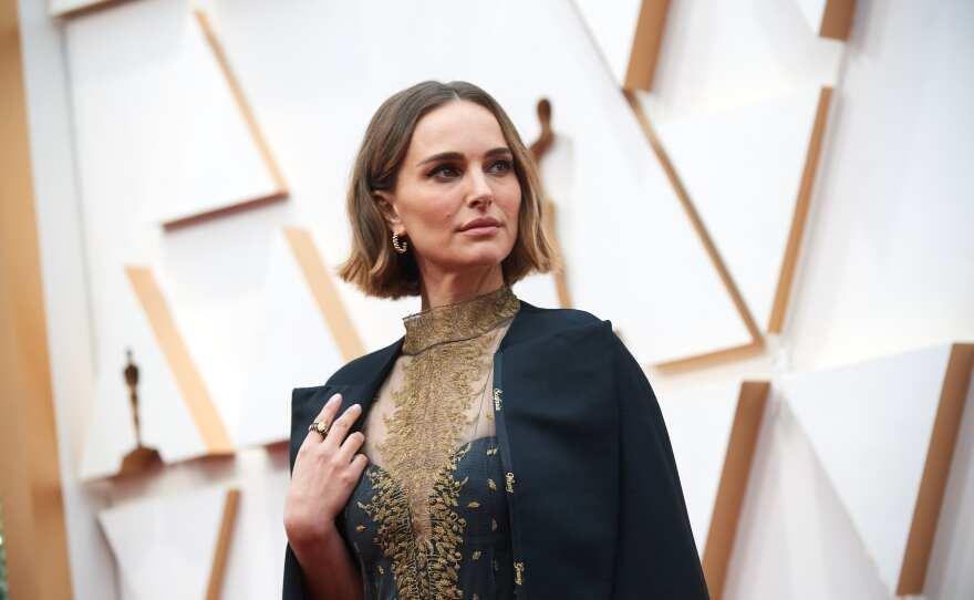 Natalie Portman arrives on the red carpet of The 92nd Oscars® at the Dolby® Theatre in Hollywood, CA on Sunday, February 9, 2020. Look closely to the edge of her cape for the names of all the women directors the Academy ignored in the Best Director category.
