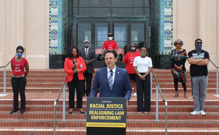 San Diego County Supervisor Nathan Fletcher speaks at a press conference with Buki Domingos, founder of Racial Justice Coalition of San Diego; Ellen Nash, chair of Black American Political Association of California; Khalid Alexander, president of Pillars of the Community; and Maresa Talbert, co-chair of San Diegans for Justice; and other activists, June 19, 2020.