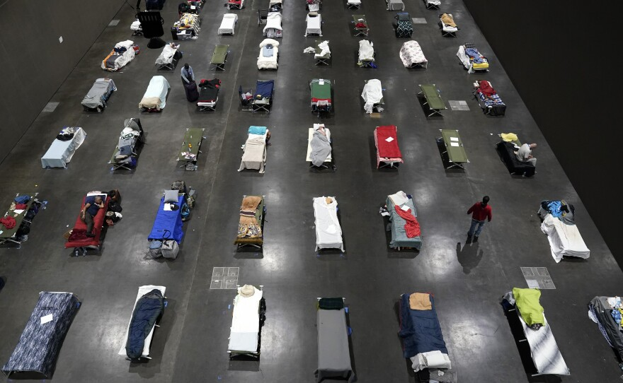 Beds fill a homeless shelter inside the San Diego Convention Center Tuesday, Aug. 11, 2020, in San Diego.