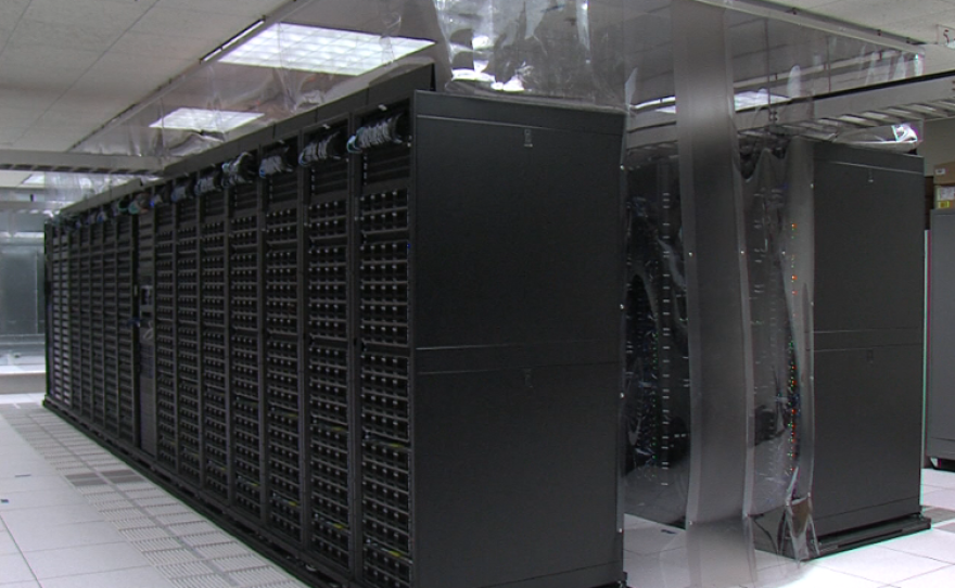 Server rows fill the San Diego Supercomputer Center, Oct. 14, 2015.