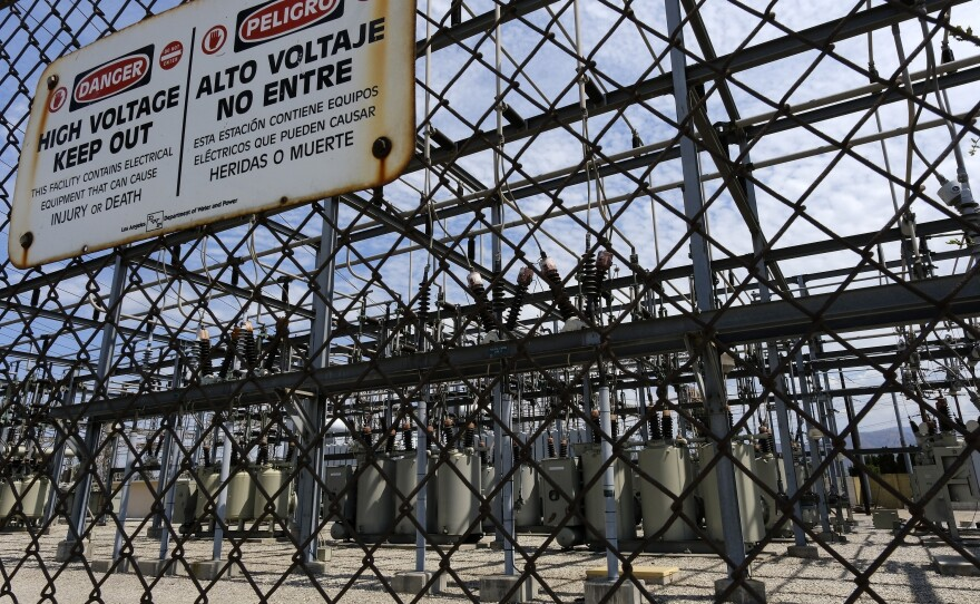 In this Aug. 15, 2020, file photo, high voltage signs are posted on the Department of Water and Power Sub Station E in the North Hollywood section of Los Angeles.