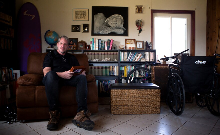 Andrew Simmons sits for a portrait in the family room of his Ramona home on Jan. 30, 2020. Photo by Lisa Hornak for CalMatters.