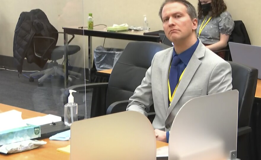 In this image from video, former Minneapolis police Officer Derek Chauvin listens as his defense attorney Eric Nelson gives closing arguments as Hennepin County Judge Peter Cahill preside Monday, April 19, 2021, in the trial of Chauvin at the Hennepin County Courthouse in Minneapolis. Chauvin is charged in the May 25, 2020 death of George Floyd.