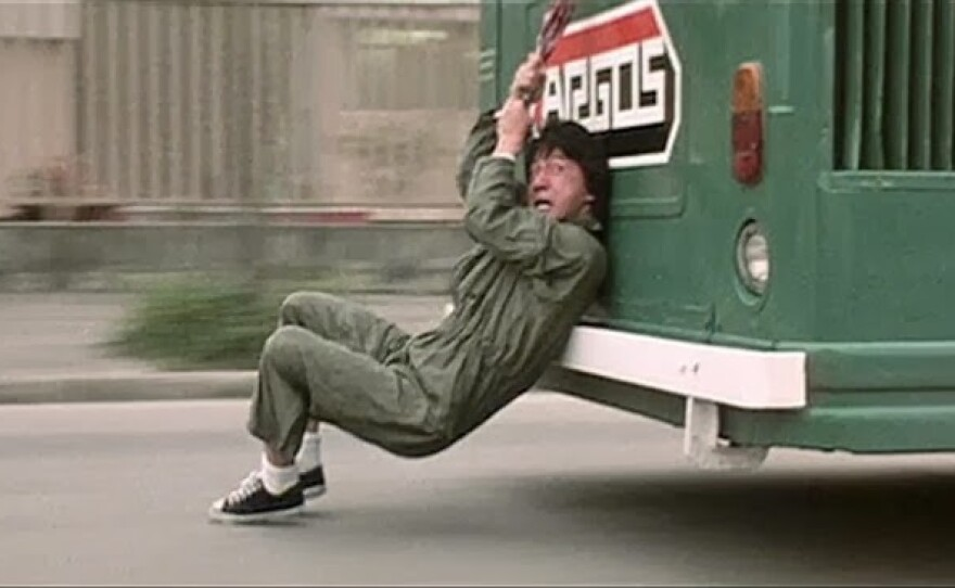 "Jackie Chan doing one of his insane stunts in ""Police Story."" The 4K digitally restored film screen as part of Film Classics Week at Landmark's Ken Cinema."
