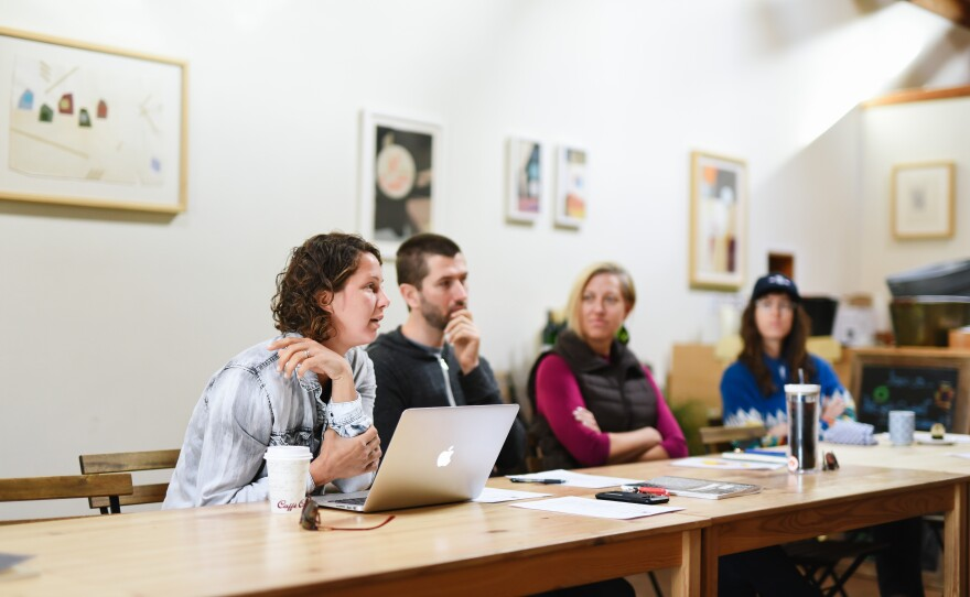 Members of Business For Good San Diego are pictured at a meeting.