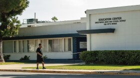 A man walking by the Sweetwater Union Hgh School District Education Center in Chula Vista on Aug. 3, 2020.
