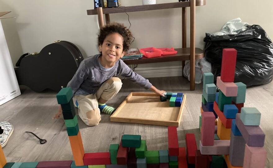 Eli Chery-Davenport, 5, plays with blocks. Jan. 31, 2021