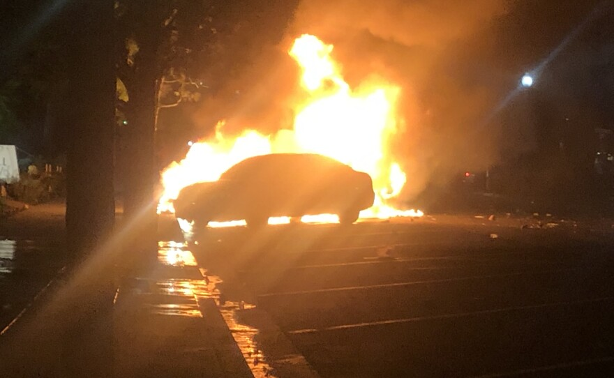 A car on fire during a protest in La Mesa, May 30, 2020.