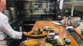 Chef Bernard Guillas preparing a holiday meal at The Marine Room restaurant on Dec. 19, 2018.