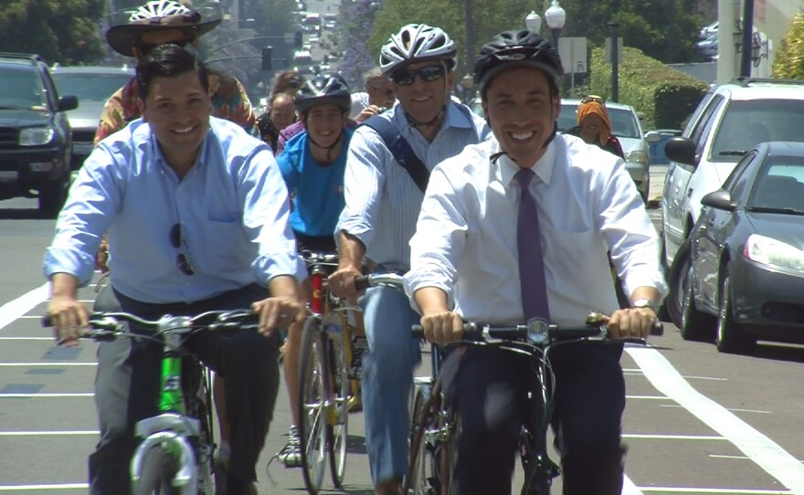 City Councilman Todd Gloria rides a bike to show off the San Diego Bike Loop, May 27, 2014.