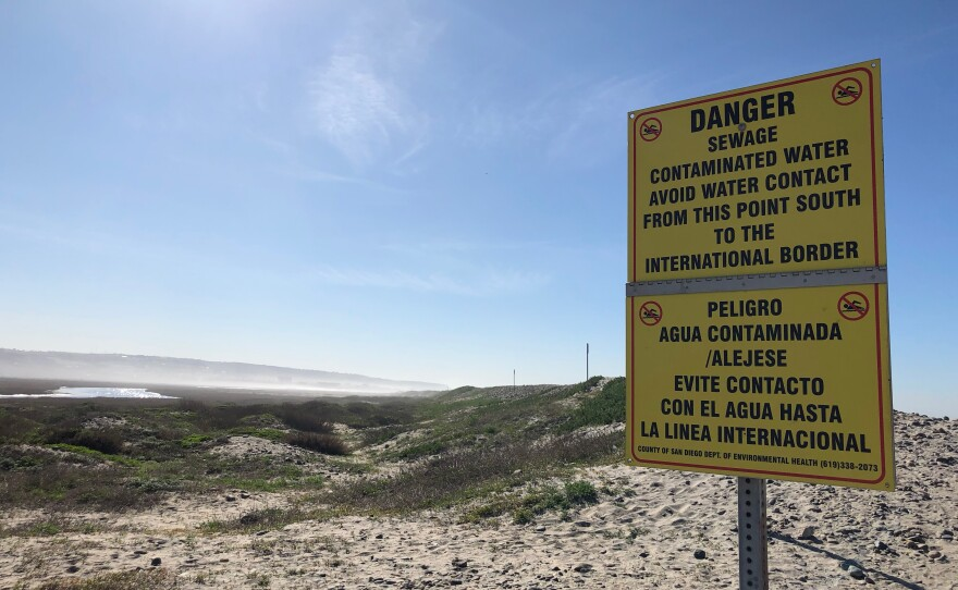 Sign warning of pollution on Imperial Beach on Jan. 30, 2020
