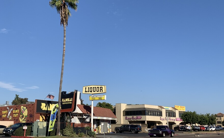 A liquor store and massage parlor are seen here in the Midway District, Oct. 16, 2020.