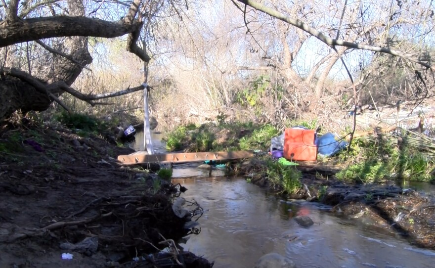 Trash left behind from homeless encampments at the Quarry Creek Preserve in Oceanside. February 18, 2021.