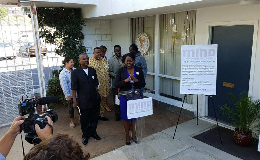 Nile Sisters Development Initiative Senior Program Manager Rebecca Paida, who also chairs the San Diego Refugee Forum, speaks at a news conference announcing a refugee mental health toolkit, Oct. 10, 2017.