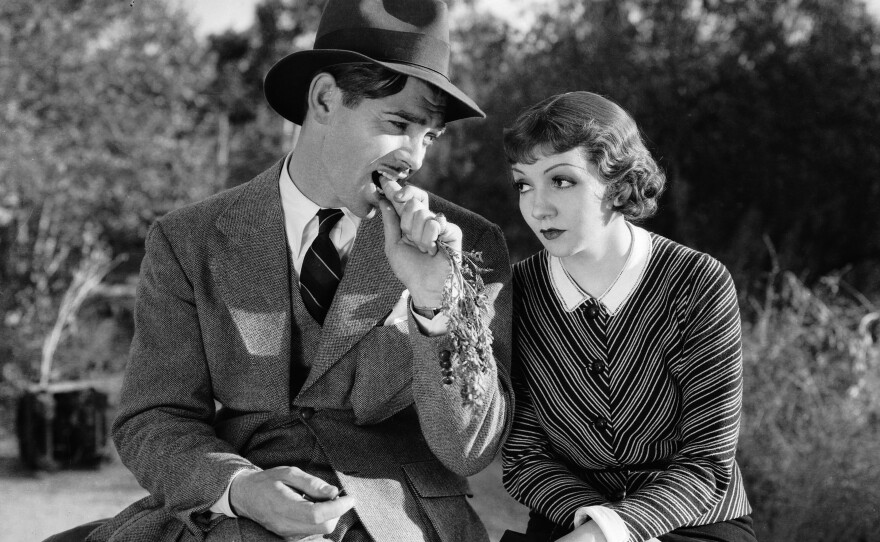 """Clark Gable plays a newspaper reporter and Claudette Colbert is a runaway heiress in Frank Capra's screwball comedy """"It Happened One Night."""" (1934)"""