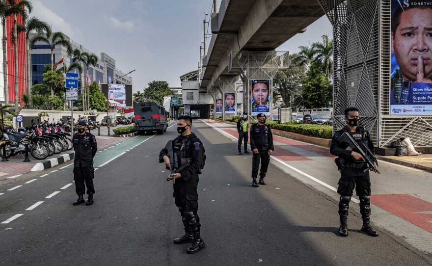 Indonesian police guard the site of Saturday's ASEAN emergency summit in Jakarta, which drew protests over the invitation of Myanmar's military general.