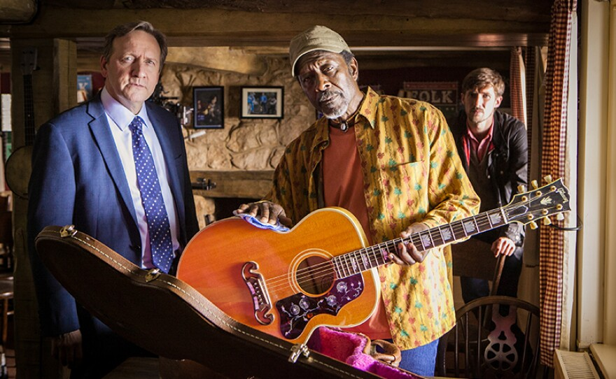 """A scene from """"The Ballad of Midsomer County"""" featuring DCI John Barnaby (Neil Dudgeon), Frank Wainwright (Clarke Peters) and DS Charlie Nelson (Gwilym Lee). Could a ballad made famous by late, lamented folk singer Johnny Carver be an inspiration for murder."""