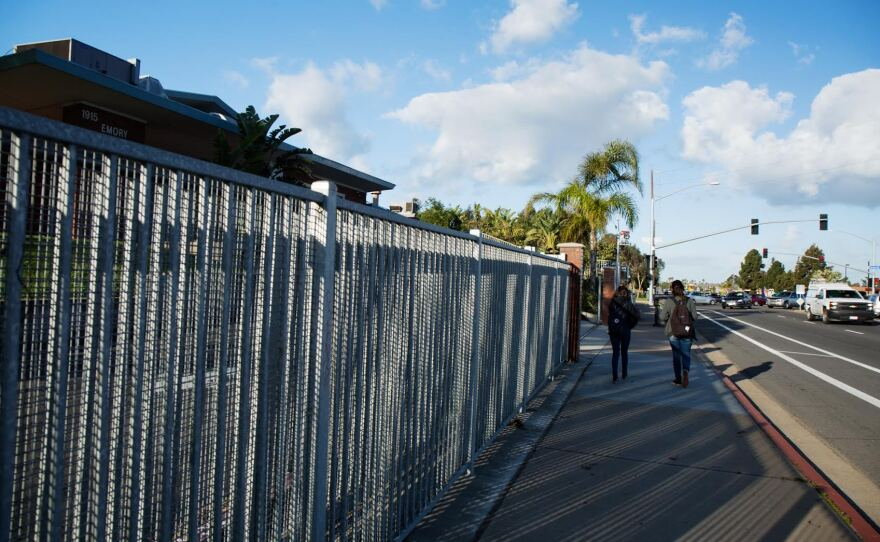 Two students walk past the front gate of Emory Elementary on Feb. 23, 2017. The school is part of the South Bay Union School District which reported 20 percent of its students were homeless in the 2015-16 school year.