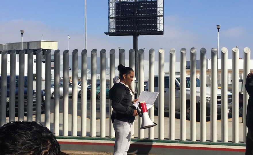 A migrant calls out numbers from the unofficial list of asylum-seekers in Tijuana on July 16, 2019