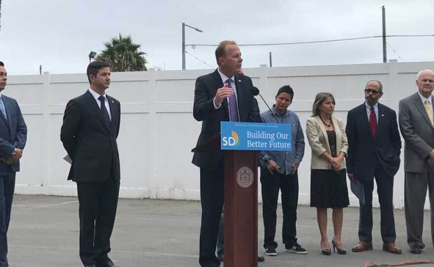 San Diego Mayor Kevin Faulconer announces a plan to open up industrial tents as temporary shelters for the homeless, Sept. 13, 2017.