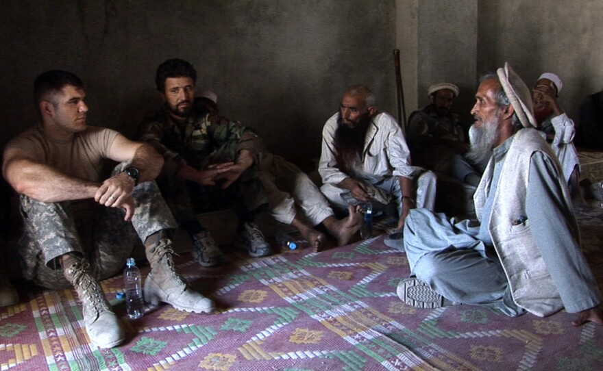"""The soldiers meet with local Afghan villagers in """"Restrepo"""""""